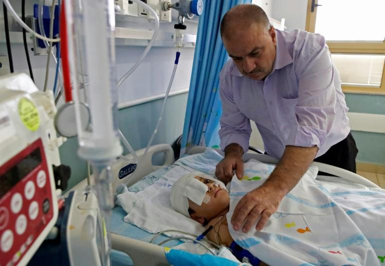 Yassir Shtewi sleeps each night by his son's bed in an Israeli hospital