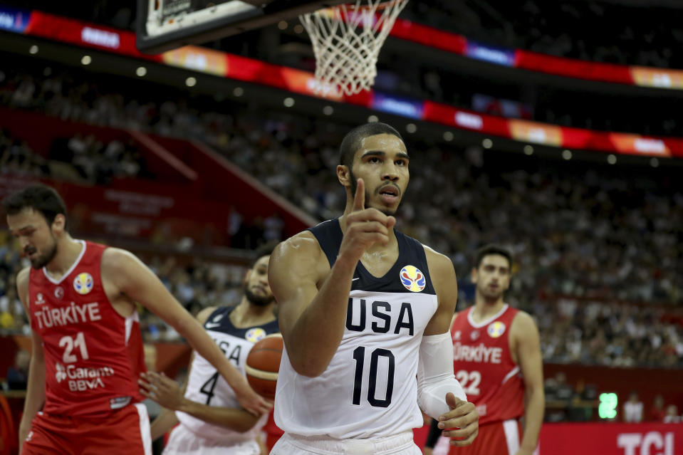 FILE - United States' Jayson Tatum reacts after scoring against Turkey in a FIBA Basketball World Cup basketball game at the Shanghai Oriental Sports Center in Shanghai, in this Tuesday, Sept. 3, 2019, file photo. Kobe Bryant wore No. 24 and No. 8 with the Los Angeles Lakers, but he donned No. 10 for USA Basketball when he helped the Americans capture gold medals at the 2008 and 2012 Olympics. Tatum has worn that number as part of U.S. teams several times since — and will wear it at the Tokyo Olympics, where the Americans will aim to capture a fourth consecutive gold medal. (AP Photo/Ng Han Guan, File)
