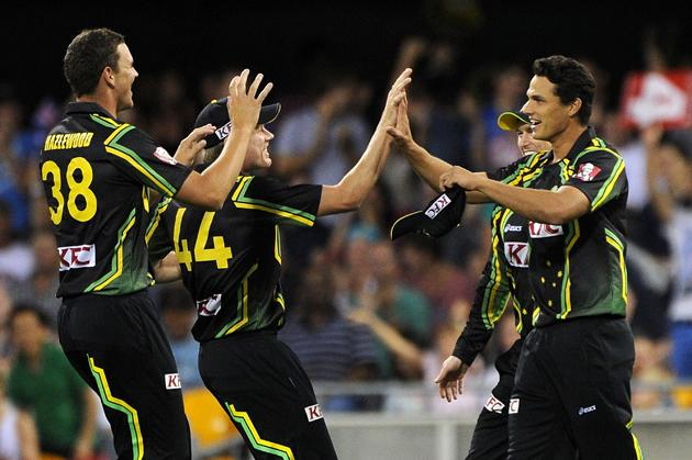 BRISBANE, AUSTRALIA - FEBRUARY 13:  Nathan Coulter-Nile (R) of Australia celebrates a wicket with team mates during the International Twenty20 match between Australia and the West Indies at The Gabba on February 13, 2013 in Brisbane, Australia.  (Photo by Matt Roberts/Getty Images)