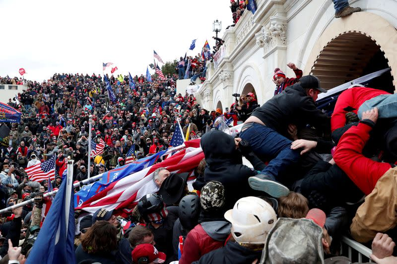 FILE PHOTO: Supporters of U.S. President Donald Trump storm into the U.S. Capitol