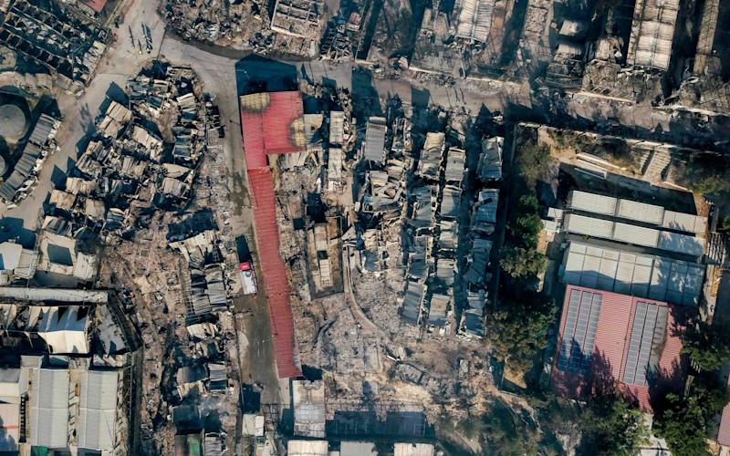 An aerial view of the burnt-out camp - AFP