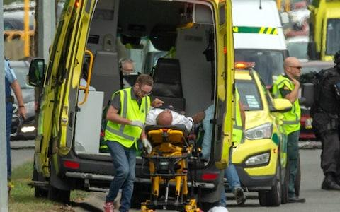 An injured person is loaded into an ambulance at the Al Noor mosque in Christchurch - Credit: Reuters