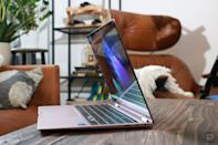 <p>Samsung Galaxy Book Pro 360 review pictures. Side view of the Galaxy Book Pro 360 sitting on a desk with its screen slightly tilted inwards.</p>