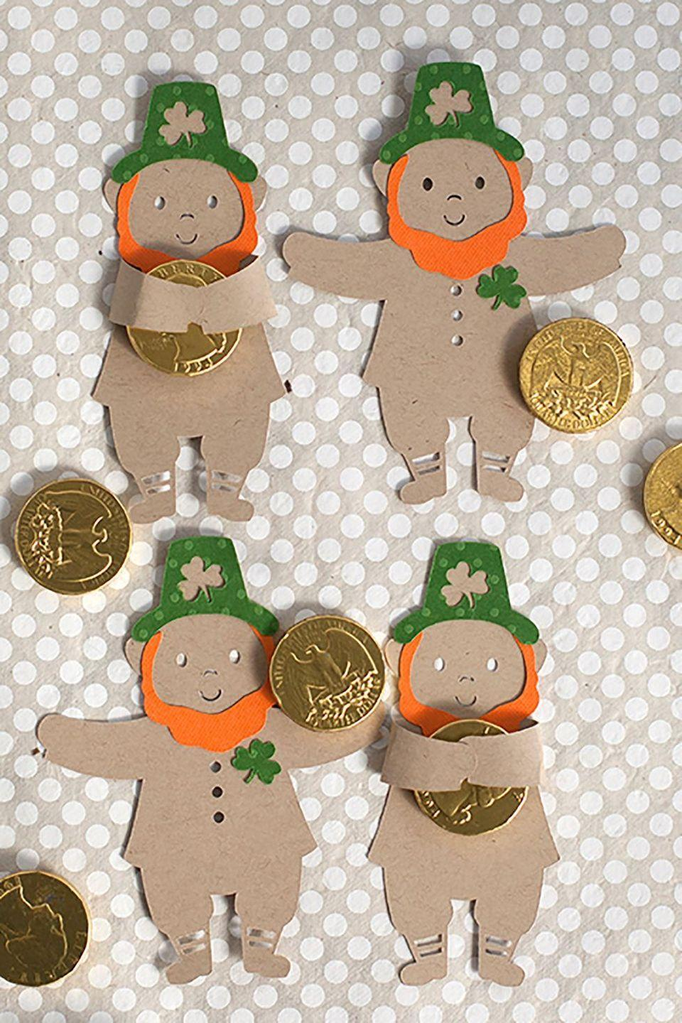 """<p>These adorable paper leprechauns are perfect for hugging gold coins, and inspiring some hugs from your little ones, too. </p><p><em>Get the tutorial at<a href=""""https://liagriffith.com/st-patricks-day-crafts-leprechaun-candy-hugger/?sscid=21k4_fvpv4"""" rel=""""nofollow noopener"""" target=""""_blank"""" data-ylk=""""slk:Lisa Griffith"""" class=""""link rapid-noclick-resp""""> Lisa Griffith</a>. </em></p>"""