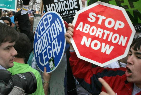 Pro-life demonstrators (R) confront pro-choice counterparts (L). Photo from Getty Images.