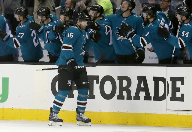 FILE - In this April 16, 2018, file photo, San Jose Sharks center Eric Fehr (16) is congratulated by teammates after scoring a goal against the Anaheim Ducks during the second period of Game 3 of an NHL hockey first-round playoff series in San Jose, Calif. Fehr and Marcus Sorensen spent most of the season toiling in the AHL, just waiting for their chance. That opportunity has arrived in the playoffs for San Jose and those two fourth-line forwards are a major reason why the Sharks swept Anaheim to advance to a second-round series against Vegas. Fehr scored one goal while anchoring the fourth line and Sorensen had three as San Jose's bottom group of forwards that also includes Melker Karlsson matched the scoring output of the entire Anaheim team in the series. (AP Photo/Jeff Chiu, File)