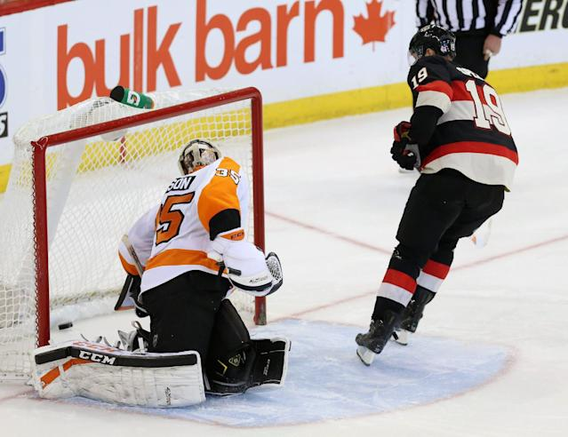 Ottawa Senators Jason Spezza (19) gets the puck past Philadelphia Flyer goaltender Steve Mason (35) in a shoot out during an NHL hockey game against the Philadelphia Flyers on Monday, Dec. 9, 2013. in Ottawa, Ontario. (AP Photo/The Canadian Press, Fred Chartrand)
