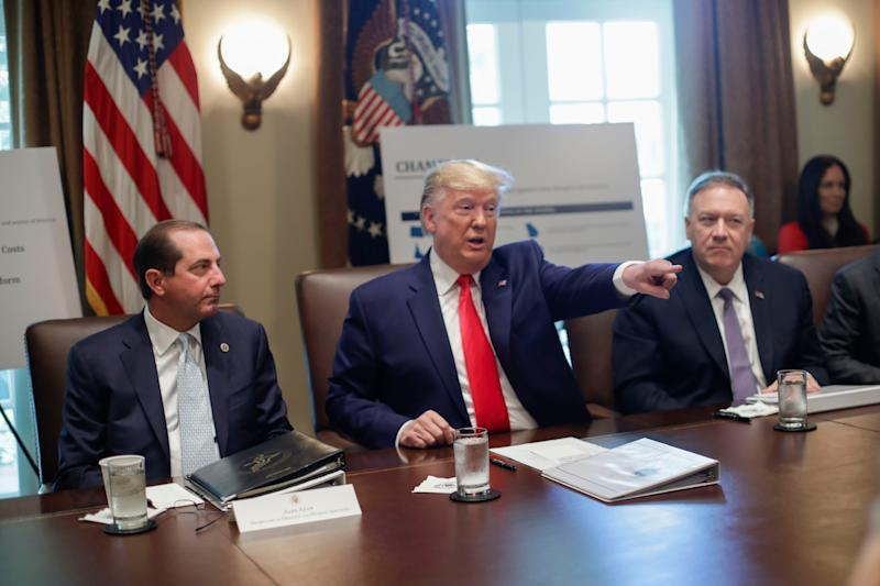 President Donald Trump, center, points to members of his Cabinet while speaking during a Cabinet meeting in the Cabinet Room of the White House, Monday, Oct. 21, 2019, in Washington, as Health and Human Services Secretary Alex Azar, left, and Secretary of State Mike Pompeo, right, listen. (AP Photo/Pablo Martinez Monsivais) ORG XMIT: DCPM107