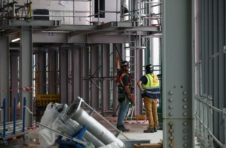Workers are seen at the construction site of 22 Bishopsgate in London