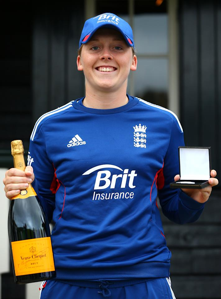 HIGH WYCOMBE, ENGLAND - AUGUST 14:   Heather Knight of England pose with the player of the match award during day four of the Women's Ashes Series match between England and Australia at Wormsley Cricket Ground on August 14, 2013 in High Wycombe, England.  (Photo by Jan Kruger/Getty Images)
