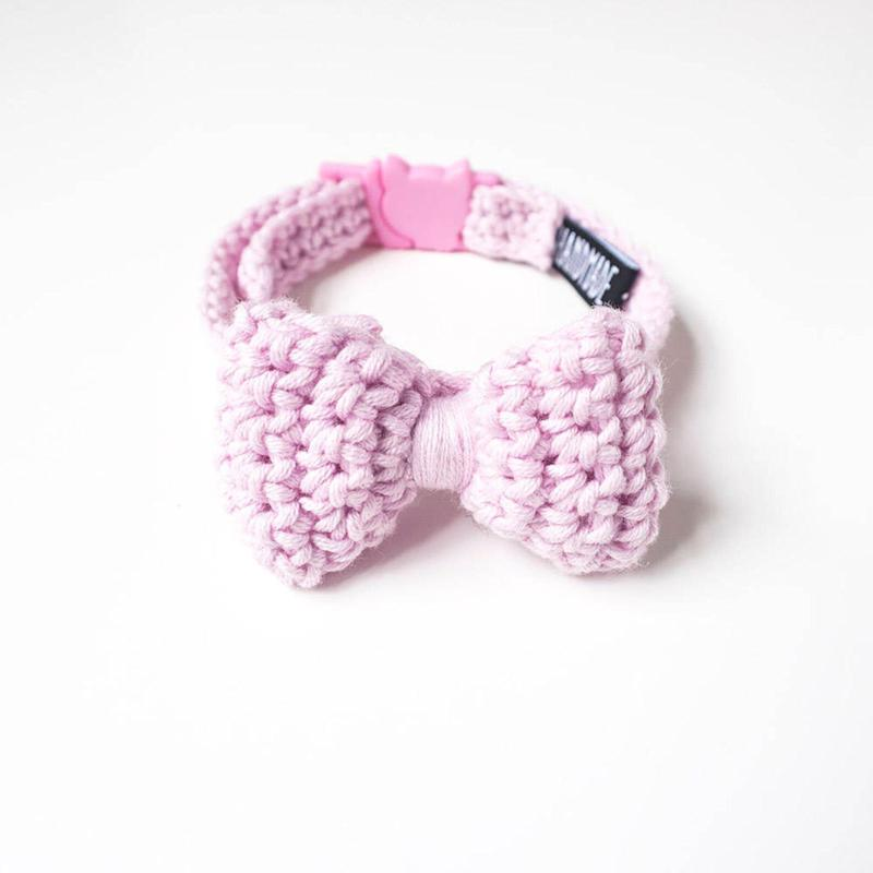 "<a href=""https://fave.co/2PcKtxI"" target=""_blank"" rel=""noopener noreferrer"">Light Pink Crochet Cat Collar Bow Tie, Sniff Me Tender, via Not On the High Street</a>, &pound;22.90 (Photo: HuffPost UK)"