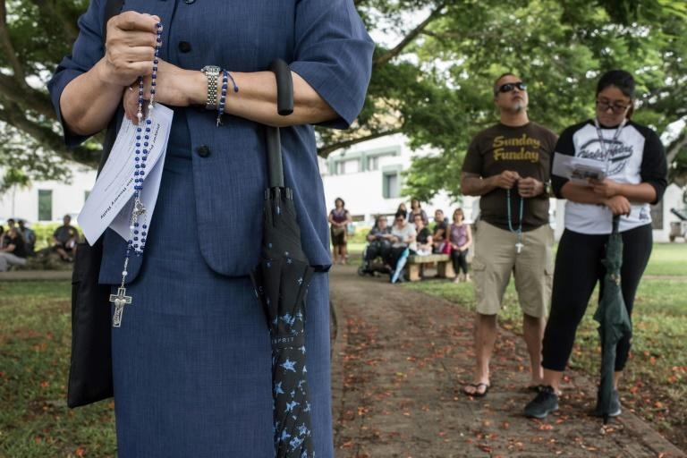 """Catholic worshippers attend a """"prayers for peace"""" rally marking the 100th anniversary of Our Lady of Fatima in Hagatna on August 13, 2017"""
