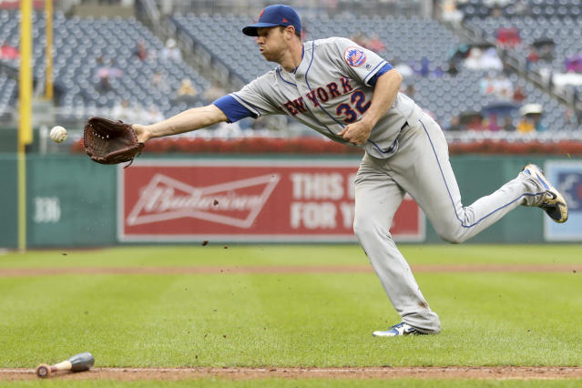 New York Mets pitcher Steven Matz makes a fielders choice out at home plate during the third inning of a baseball game against the Washington Nationals at Nationals Park, Sunday, Sept. 23, 2018, in Washington. (AP Photo/Andrew Harnik)
