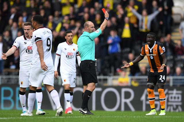 <p>Oumar Niasse sees red for relegation-threatened Hull in the early exchanges of the crucial clash against Watford </p>