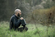 """This image released by A24 shows director David Lowery on the set of """"The Green Knight."""" (Eric Zachanowich/A24 via AP)"""