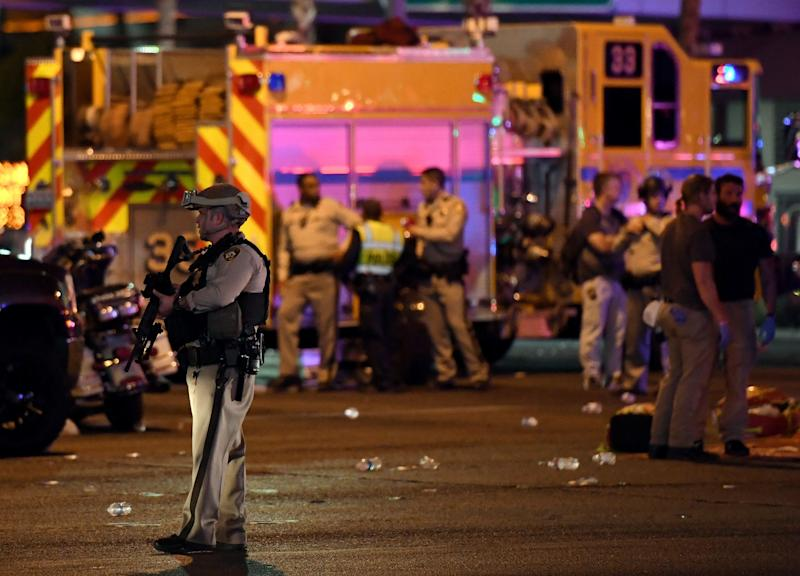 A police officer stands in the intersection of Las Vegas Boulevard and Tropicana Avenue on Oct. 2 after the mass shooting.