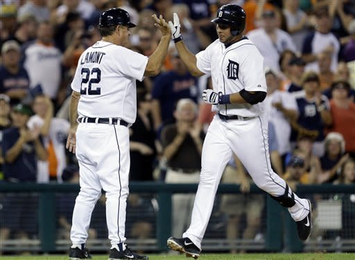 Detroit Tigers' Jhonny Peralta is congratulated on his solo home run by Tigers third base coach Gene Lamont (22) in the fourth inning of a baseball game against the Chicago White Sox in Detroit, Friday, Aug. 31, 2012. (AP Photo/Paul Sancya)