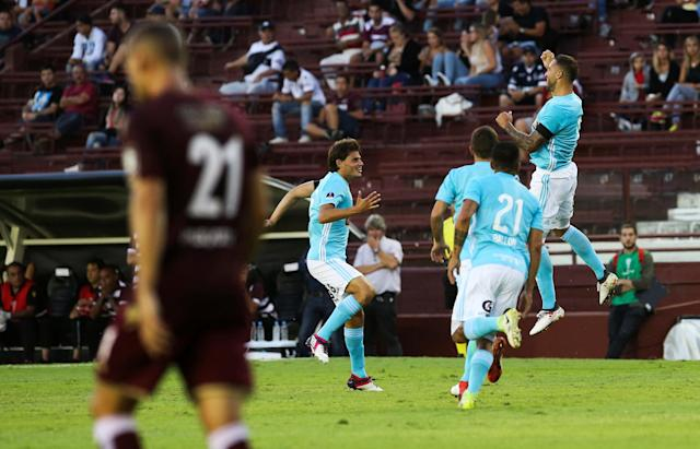 Soccer Football - Argentina's Lanus v Peru's Sporting Cristal - Copa Sudamericana - Ciudad de Lanus stadium, Buenos Aires, Argentina - February 21, 2018. Sporting Cristal's Emanuel Herrera (in the air) celebrates with his teammates after scoring. REUTERS/Agustin Marcarian