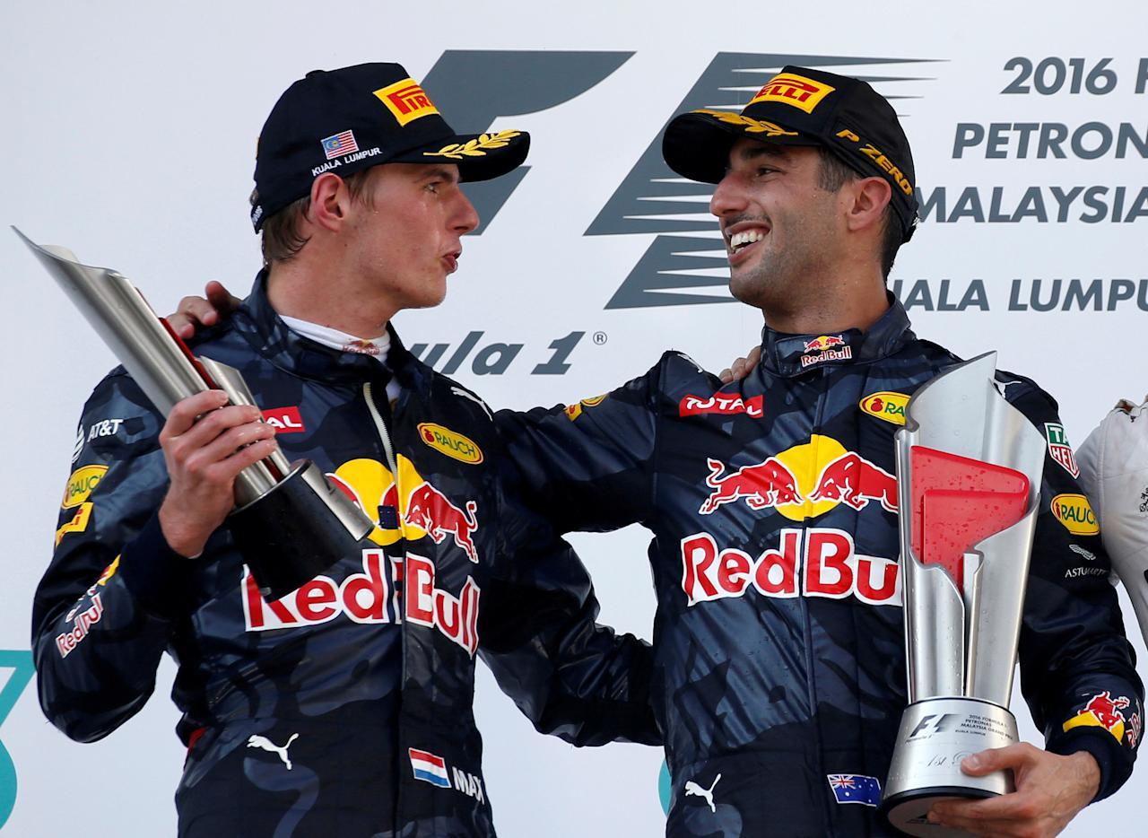 FILE PHOTO: Formula One - F1 - Malaysia Grand Prix - Sepang, Malaysia- 2/10/16.  Red Bull's Daniel Ricciardo of Australia celebrates with Red Bull's Max Verstappen of the Netherlands on the podium. REUTERS/Edgar Su/File Photo