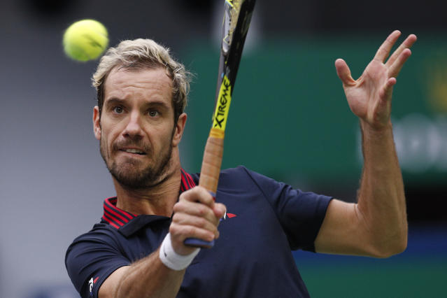 Richard Gasquet of France hits a return shot to Juan Martin del Potro of Argentina during their men's singles match in the Shanghai Masters tennis tournament in Shanghai, China, Wednesday, Oct. 10, 2018. (AP Photo/Andy Wong)