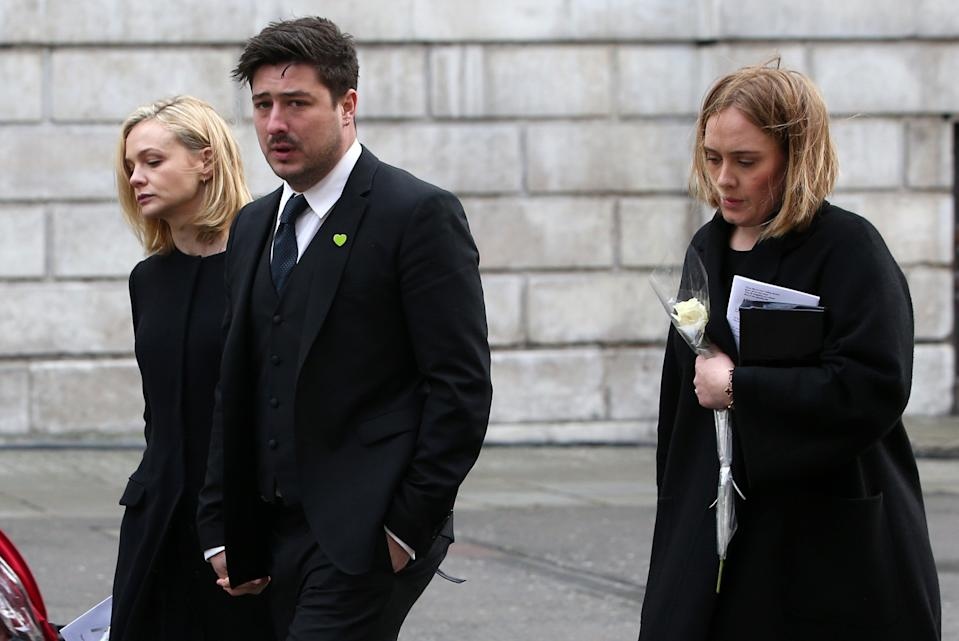 (From left) Carey Mulligan, Marcus Mumford, Adele attend the Grenfell memorial. (Credit: REX)