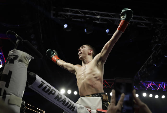 Ireland's Michael Conlan gestures to fans after a featherweight boxing match against Mexico's Ruben Garcia Hernandez on Sunday, March 17, 2019, in New York. Conlan won the fight. (AP Photo/Frank Franklin II)
