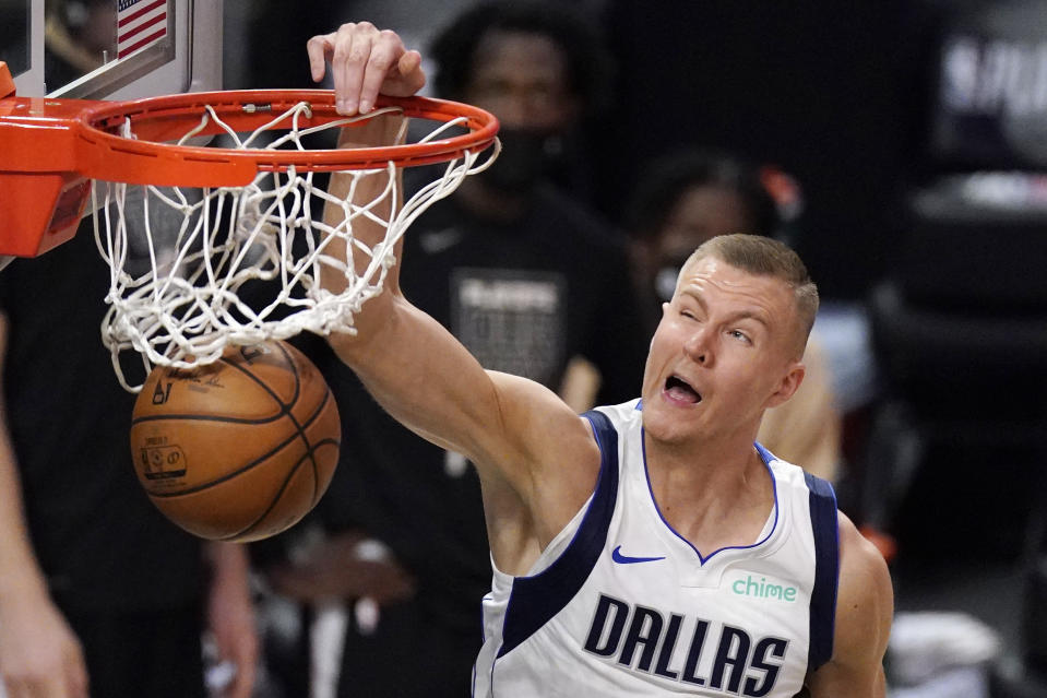 Dallas Mavericks center Kristaps Porzingis dunks during the second half in Game 1 of an NBA basketball first-round playoff series against the Los Angeles Clippers Saturday, May 22, 2021, in Los Angeles. (AP Photo/Mark J. Terrill)