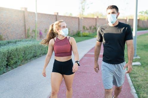 "<span class=""caption"">Walking is an easy exercise for everyone to do.</span> <span class=""attribution""><a class=""link rapid-noclick-resp"" href=""https://www.shutterstock.com/image-photo/athletic-young-man-woman-wearing-face-1767653012"" rel=""nofollow noopener"" target=""_blank"" data-ylk=""slk:antoniodiaz/ Shutterstock"">antoniodiaz/ Shutterstock</a></span>"