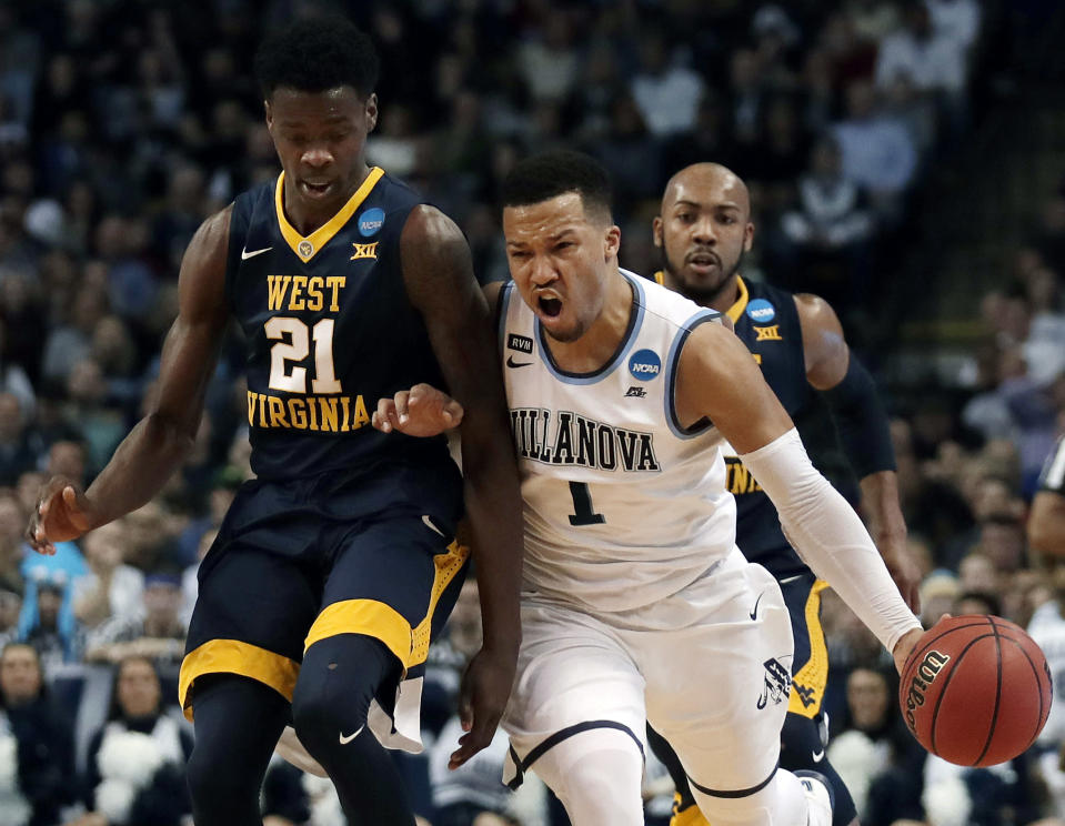 Villanova's Jalen Brunson, right, tries to drive past West Virginia's Wesley Harris, left, during the first half of an NCAA men's college basketball tournament regional semifinal Friday, March 23, 2018, in Boston. (AP Photo/Charles Krupa)