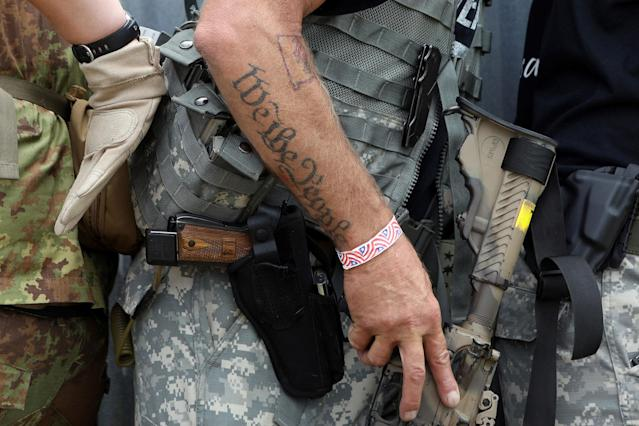 "<p>A tattoo reads ""We the People"" as members of self-described patriot groups and militias run through close quarter combat shooting drills during III% United Patriots' Field Training Exercise outside Fountain, Colo., July 29, 2017. (Photo: Jim Urquhart/Reuters) </p>"