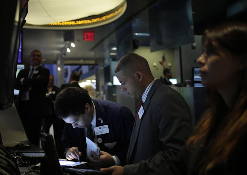 Traders work on the floor at the New York Stock Exchange in New York, Tuesday, Sept. 3, 2013. (AP Photo/Seth Wenig)