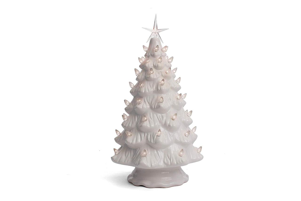 """<p><strong>BUY IT: $39.99;<em> <a href=""""https://www.amazon.com/Milltown-Merchants-Ceramic-Christmas-Tree/dp/B07JMF111G/?ie=UTF8&camp=1789&creative=9325&linkCode=as2&creativeASIN=B07JMF111G&tag=southlivin04-20&ascsubtag=d41d8cd98f00b204e9800998ecf8427e"""" target=""""_blank"""">amazon.com</a></em></strong></p> <p> With a white base and clear lights, this tree is perfect for neutral color schemes. </p>"""