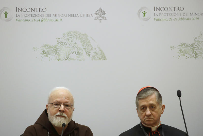 Cardinal Blase J. Cupich, Chicago Archbishop, right, and Cardinal Sean Patrick O'Malley, listen reporters' questions at a media briefing during a four-day sex abuse summit called by Pope Francis, in Rome, Friday, Feb. 22, 2019. (AP Photo/Alessandra Tarantino)
