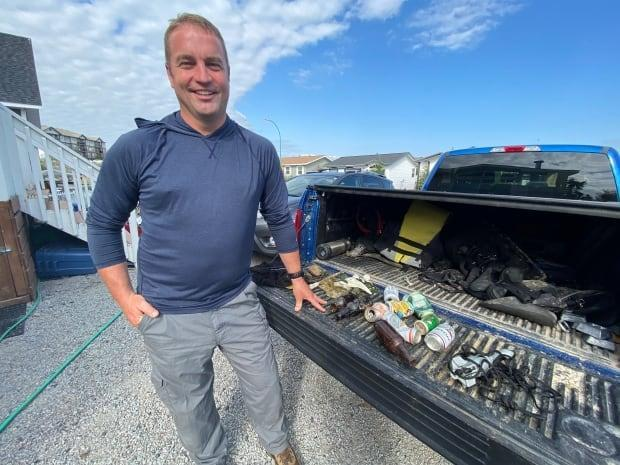 Jeremy Macdonald  collects garbage and other objects when he dives under Yellowknife waters. (Chantal Dubuc/CBC - image credit)