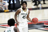 Baylor's Davion Mitchell (45) controls the ball during the first half of an NCAA college basketball game against Texas Tech in Lubbock, Texas, Saturday, Jan. 16, 2021. (AP Photo/Justin Rex)