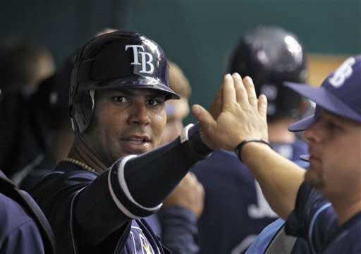 Tampa Bay Rays' Carlos Pena, left, high-fives teammates after scoring a third-inning ground out by teammate Matt Joyce off Toronto Blue Jays starting pitcher Ricky Romero during a baseball game, Wednesday, May 23, 2012, in St. Petersburg, Fla. (AP Photo/Chris O'Meara)