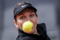 Romania's Simona Halep returns the ball to Spain's Sara Sorribes during their match at the Mutua Madrid Open tennis tournament in Madrid, Spain, Friday, April 30, 2021. (AP Photo/Bernat Armangue)
