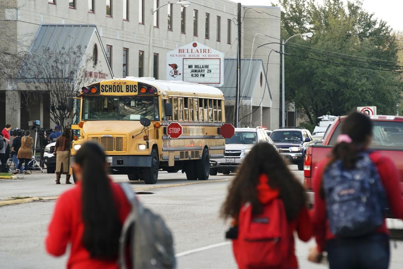 Students watch from across the street as authorities respond to a shooting at Bellaire High School in Bellaire, Texas, Tuesday, Jan. 14, 2020. (Mark Mulligan/Houston Chronicle via AP)