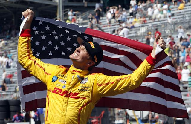 Ryan Hunter-Reay celebrates after winning the 98th running of the Indianapolis 500 IndyCar auto race at the Indianapolis Motor Speedway in Indianapolis, Sunday, May 25, 2014. (AP Photo/Tom Strattman)