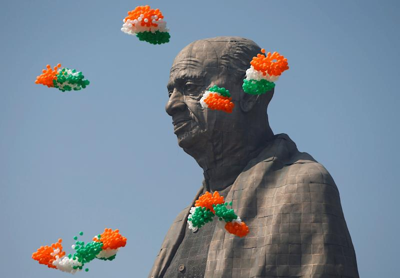 Balloons fly around the face of Sardar Vallabhbhai Patel's statue as it is formally dedicated. (Photo: Amit Dave / Reuters)