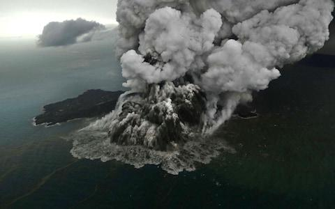 This aerial picture taken on December 23, 2018 by Bisnis Indonesia shows the Anak (Child) Krakatoa volcano erupting in the Sunda Straits off the coast of southern Sumatra and the western tip of Java
