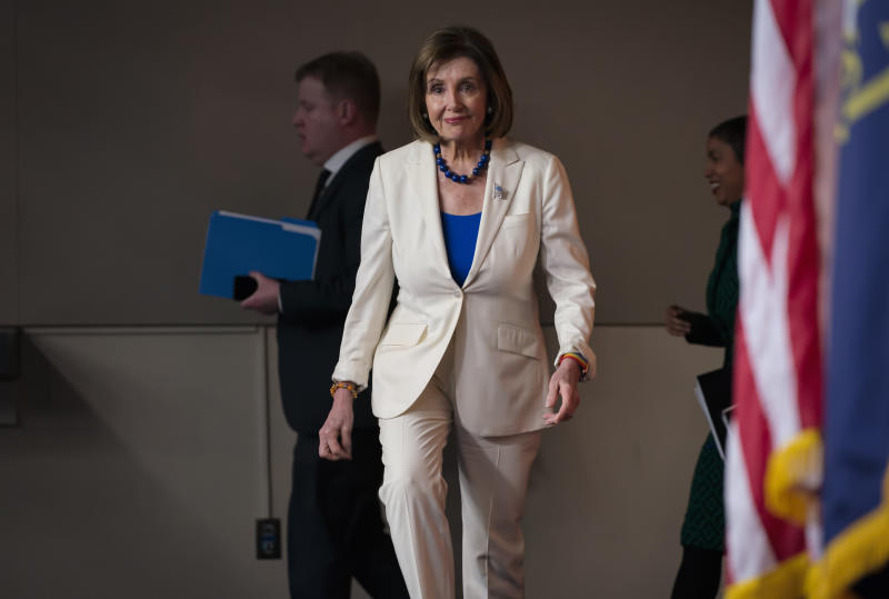 "Speaker of the House Nancy Pelosi, D-Calif., arrives to talk to reporters as the House Intelligence Committee holds public impeachment hearings of President Donald Trump's efforts to tie U.S. aid for Ukraine to investigations of his political opponents. Pelosi says there is clear evidence that President Donald Trump has used his office for his personal gain. She says doing that ""undermined the national security of the United States."" (AP Photo/J. Scott Applewhite)"
