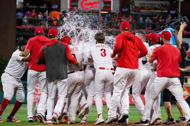 "Jun 26, 2019; Philadelphia, PA, USA; Philadelphia Phillies right fielder <a class=""link rapid-noclick-resp"" href=""/mlb/players/8171/"" data-ylk=""slk:Jay Bruce"">Jay Bruce</a> (23) is mobbed by his team after hitting a game winning RBI double during the tenth inning against the New York Mets at Citizens Bank Park. Mandatory Credit: Bill Streicher-USA TODAY Sports"