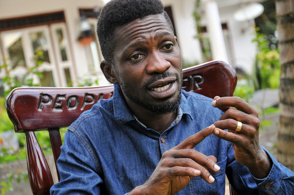 <p>'Whatever is being declared is a total sham': Bobi Wine, pictured in March 2020, says the election has been rigged</p> (AP)