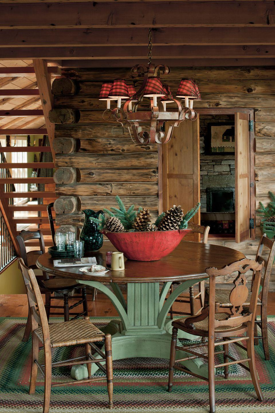 """<p>Pinecones and evergreen branches offer an unfussy alternative to a floral centerpiece in this <a href=""""https://www.countryliving.com/remodeling-renovation/home-makeovers/how-to/g1226/expanding-a-cozy-log-cabin/"""" rel=""""nofollow noopener"""" target=""""_blank"""" data-ylk=""""slk:Vermont cabin"""" class=""""link rapid-noclick-resp"""">Vermont cabin</a>.</p>"""