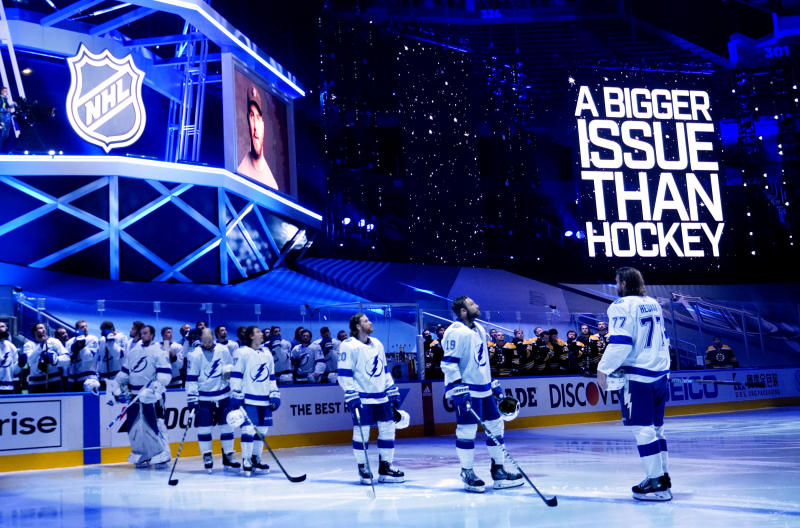 TORONTO, ONTARIO - AUGUST 29: Tampa Bay Lightning players watch as a video message plays on arena screens to show solidarity against racism before Game Four of the Eastern Conference Second Round against the Boston Bruins during the 2020 NHL Stanley Cup Playoffs at Scotiabank Arena on August 29, 2020 in Toronto, Ontario. (Photo by Mark Blinch/NHLI via Getty Images)