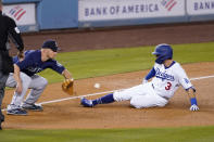 Los Angeles Dodgers' Chris Taylor, right, is safe at third for a triple ahead of the tag of Seattle Mariners third baseman Kyle Seager during the fourth inning of an interleague baseball game Tuesday, May 11, 2021, in Los Angeles. (AP Photo/Mark J. Terrill)