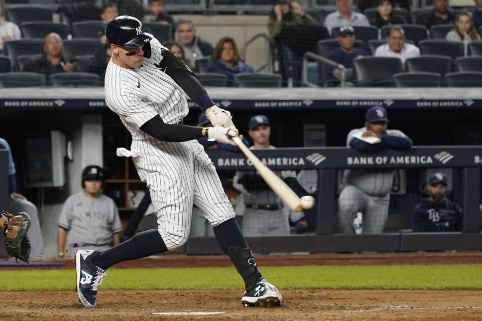 New York Yankees' Aaron Judge singles in the sixth inning of a baseball game against the Tampa Bay Rays, Friday, Oct. 1, 2021, in New York. (AP Photo/Mary Altaffer)