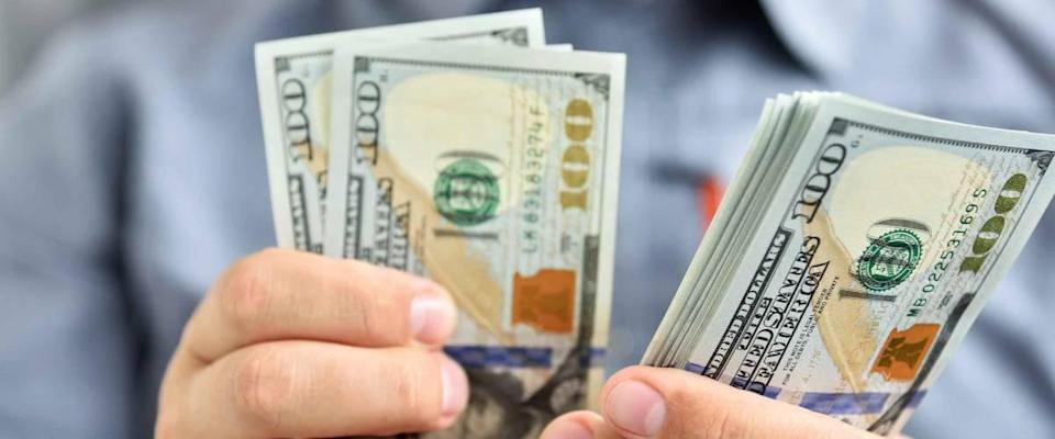 Businessman counting hundred dollar bills. Money and trade concept. Close up