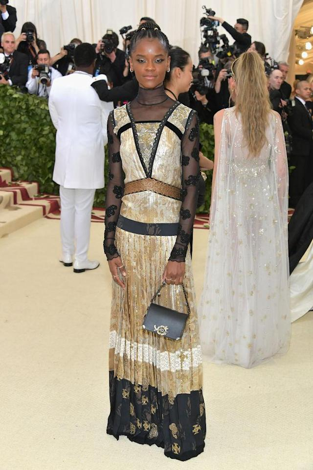 <p>Attending her first Met Gala, Wright wore a custom dress by Chanel with hand embroidered crosses. (Photo: Getty Images) </p>